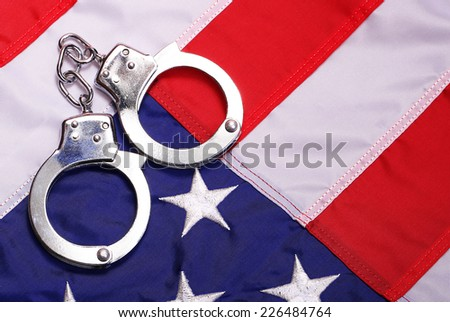 Handcuffs and American Flag