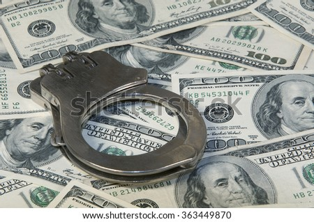 Handcuffs and cash