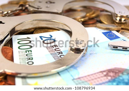 Handcuffs and Euro Money / economic fraud - stock photo