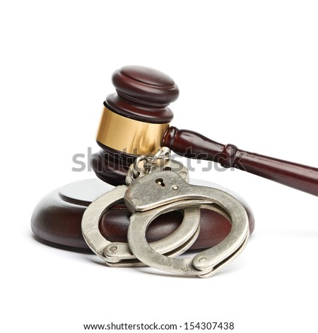 handcuffs and gavel - stock photo