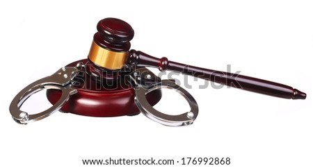Handcuffs and Judge Gavel isolated on white background - stock photo