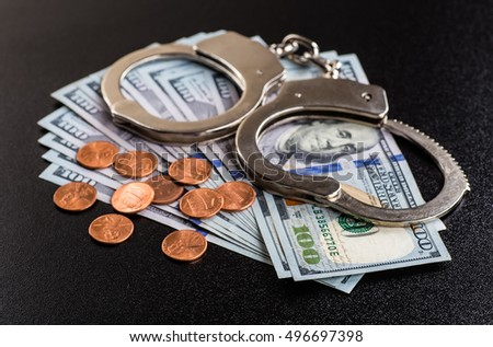 Handcuffs and money on the table