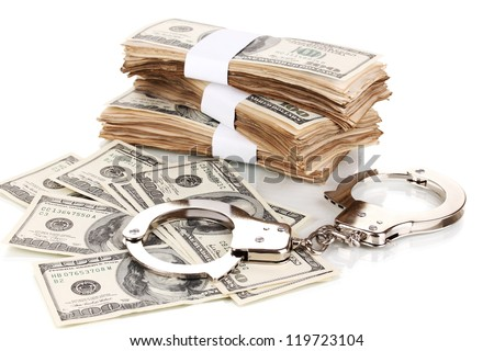 Handcuffs and packs of dollars isolated on white - stock photo