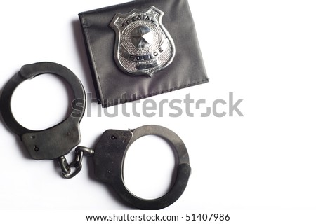 handcuffs and police badge isolated - stock photo