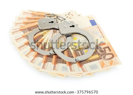 handcuffs on euro banknotes, corruption, theft or bribery concept - stock photo