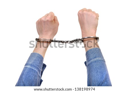 Handcuffs on Hands closeup Isolated on the White Background - stock photo