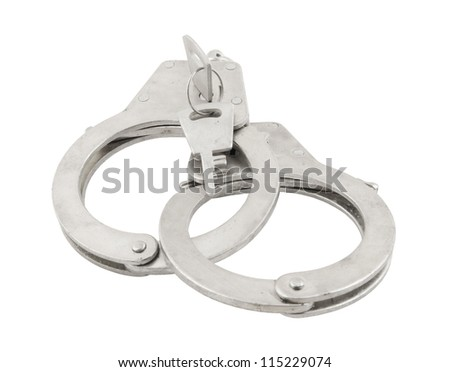 Handcuffs with keys isolated on white - stock photo