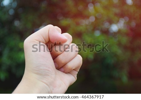 handful Human with nature background. Represents hope.