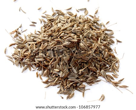 Handful of caraway seeds on a white background close up