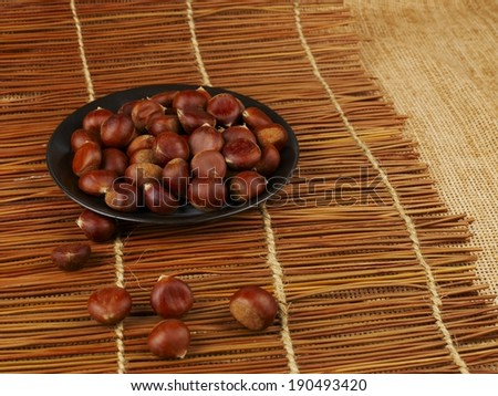 Handful of chestnuts on table