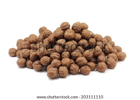 handful of chocolate balls on white background