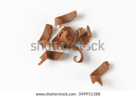 handful of chocolate shavings on white background