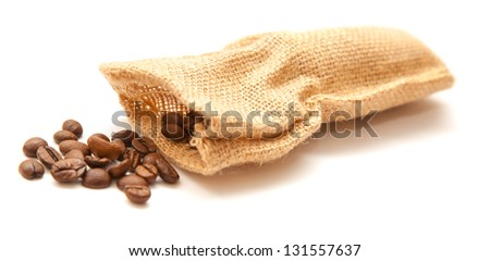 handful of coffee beans in small burlap sack