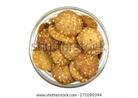 handful of cookies in a glass on a white background - stock photo