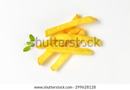 handful of french fries on white background - stock photo