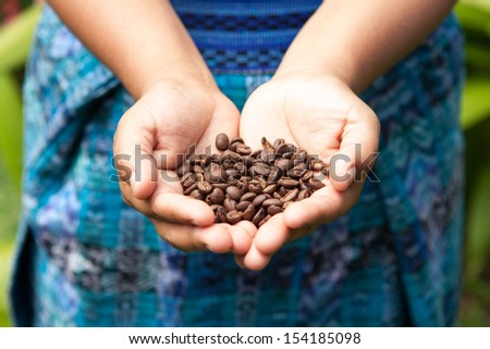 Handful of fresh organic coffee beans. Food and drink coffee background. - stock photo