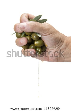 Handful of oiles and olive oil dropping from it - stock photo