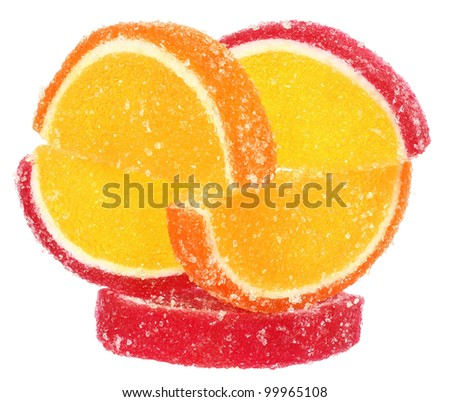 Handful of orange and yellow candy isolated.