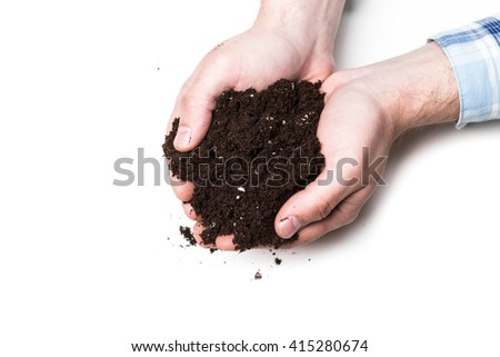 Handful of Rich Brown Soil - stock photo