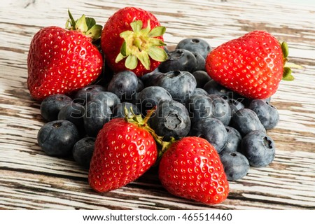 Handful or Portion of Fresh Ripe Juicy Strawberries and Blueberries Fruit