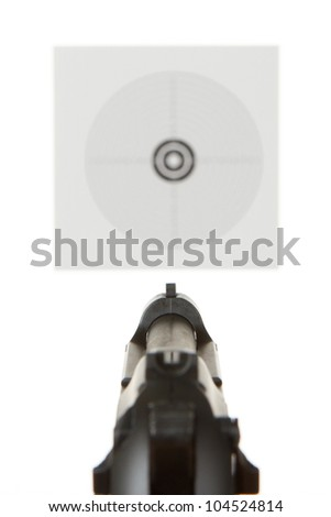 Handgun aimed on a shooting target in the background - stock photo