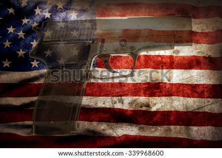 Handgun and American flag - stock photo