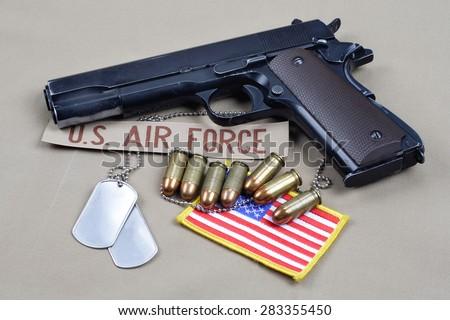 handgun on air forrce uniform - stock photo