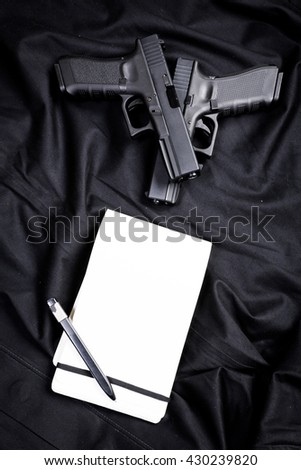 handgun on black background