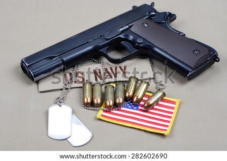 handgun on navy uniform - stock photo