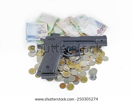 handgun on thai money banknotes and coins - stock photo
