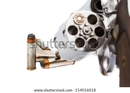 handgun revolver with bullets - stock photo