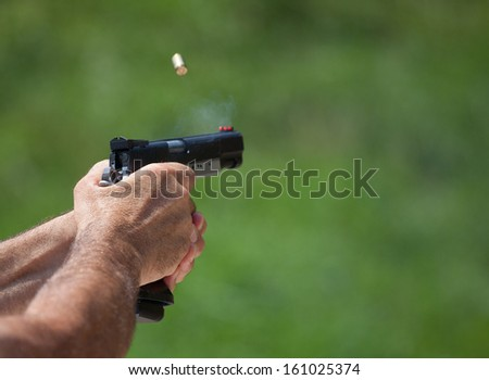 Handgun that has just delivered a single shot