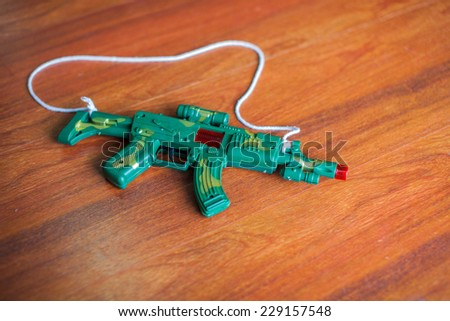 Handgun weapon - crime gun toy  - stock photo