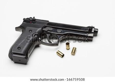 Handgun with bullets, horizontal  - stock photo