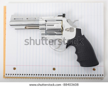 Handgun with school notebook paper.