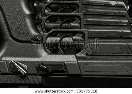 handguns in a row - stock photo