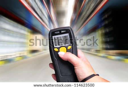 Handheld Computer for barcode scanning identification - stock photo