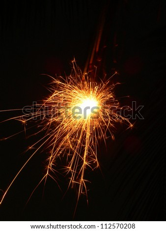 Handheld fireworks sparks flying - stock photo