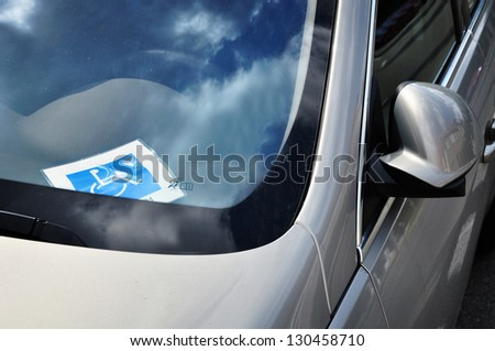 Handicap disable driver, car driving - stock photo