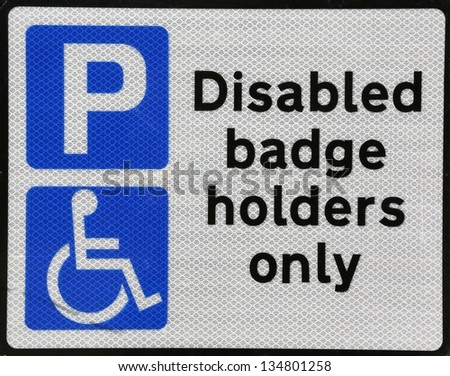 Handicap parking or wheelchair parking space sign.- - stock photo
