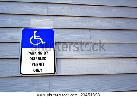 Handicap parking sign - stock photo