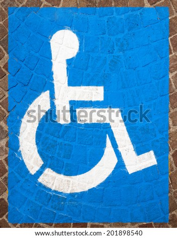 Handicap Parking Spots / Blue and white road marking for disabled parking on floor with blocks of porphyry - stock photo