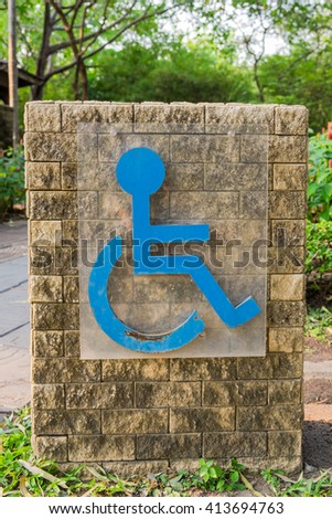 Handicap sign on stone slab
