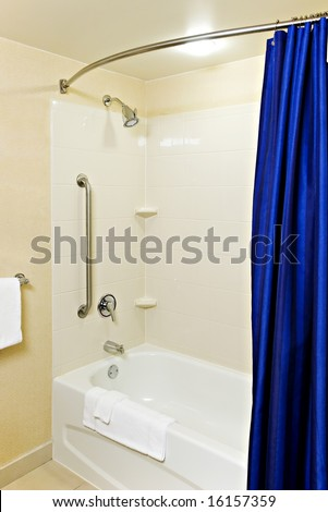Handicapped and senior-accessible tub and shower in a modern apartment or hotel - stock photo