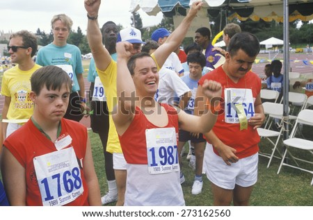 Handicapped Athletes cheering, Special Olympic games, UCLA, CA - stock photo