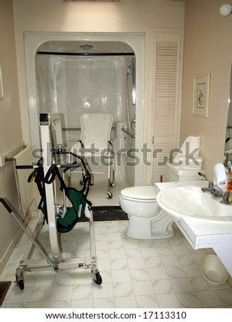 Handicapped Bathroom With Shower Chair, Lift, And Specially Designed Sink  For A Wheelchair