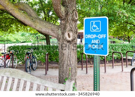 Handicapped parking sign for disabled drivers and wheelchair space. - stock photo