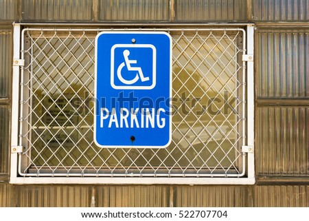 Handicapped parking sign on a window of a business