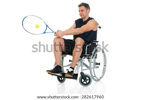 Handicapped Player On Wheelchair Playing Tennis Over White Background - stock photo