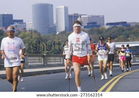 Handicapped runners participating in marathon run, Washington, DC - stock photo